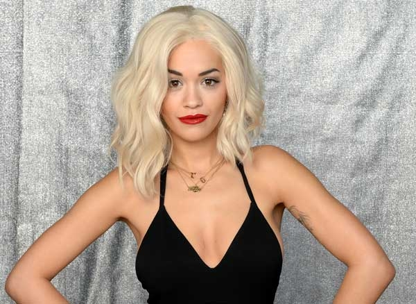 Rita Ora Seen In Netted T-Shirt At Times Sqaure
