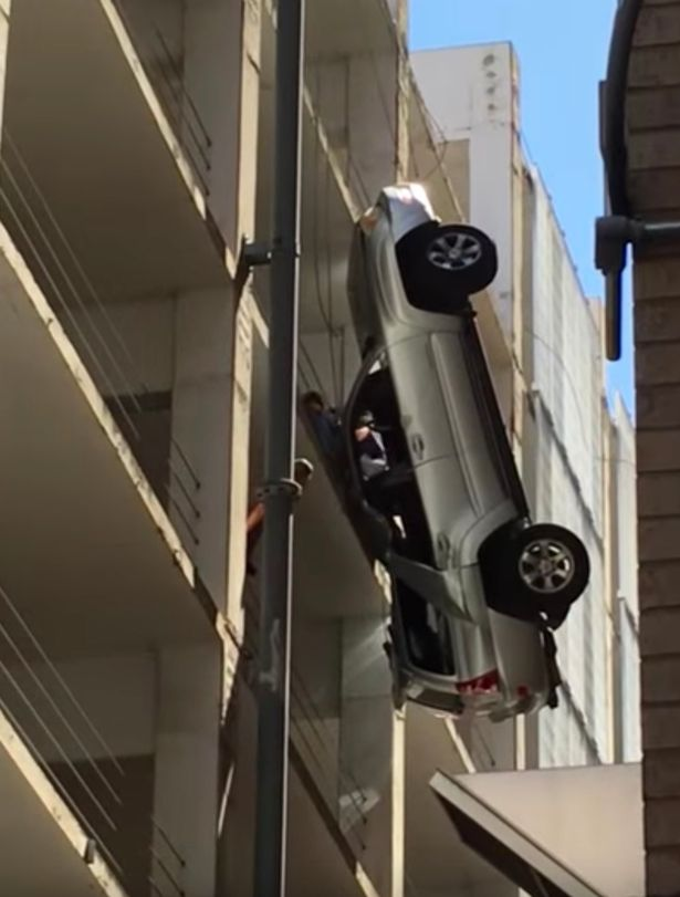 man-escaped-from-car-falling-from-9-story-building1